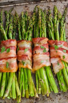 This Bacon Wrapped Asparagus recipe is made so perfectly easy in the oven. While it bakes up, the delicious flavors of brown sugar and butter come together and make this the most amazing side dish. This is simple enough to make for a weeknight meal, but impressive enough to serve at a holiday dinner.