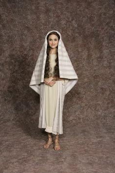 $20.00 Nativity Woman #2 cream dress w/cream fringe, lt. blue sash, lt. blue/white striped long vest & headpiece