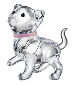 Swarovsk kitten standing Presell signed Cute Swarovski Kitten standing with a pretty pastel pink plastic collar. Displayed with the sitting blue collar kitten and the Swarovski Cat, this makes an adoable Cat family.