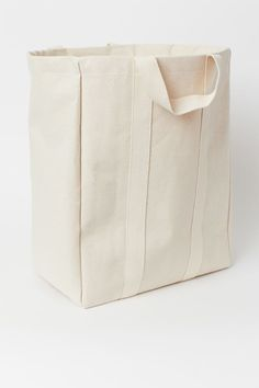 Laundry bag in canvas made from a cotton blend with two handles at the top. Thinner top section in woven fabric with a drawstring closure. Plastic coating i Canvas Laundry Bag, Laundry Bags, Laundry Rooms, H & M Home, Gift Card Shop, Plastic Coating, North And South America, Music Gifts, H&m Gifts