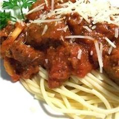 Spaghetti with Tomato and Sausage Sauce (No mushrooms or wine, and chicken sausage for my family.)