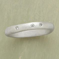 Comfort Ring Item No. 36343 $320.00 Its gently squared shape feels exceptionally good on the finger, and its diamond trio brings comfort in hard times. Saundra Messinger 's gem placement is unique to every ring. Matte sterling silver; handcrafted in USA. Whole sizes 5 to 9.