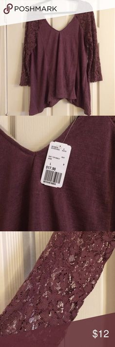 Knit Top V neck cut in front and back. Very pretty lace sleeves. Wine color. Never worn. Has tags. Forever 21 Tops