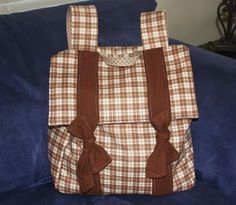 This is the backpack tutorial I used for Gracie's school bag this year. Reduced width, hight, and sides by 2 inches though. Oh, and I stitched my ties so they didn't actually tie to each other, used magnetic closures under flap for easier closing. Very Easy! Super Cute!
