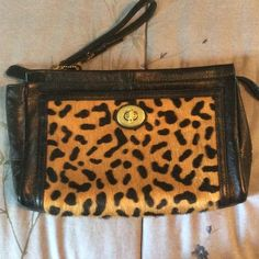 """Coach Park Leopard Calf Hair Clutch Excellent condition - used only 1 time - Leopard calf hair print and black leather Park clutch. Gold satin lining. Measures about 11.5"""" wide and 7.25"""" height. Coach Bags Clutches & Wristlets"""