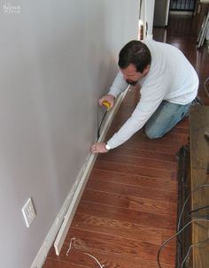 A man wants more storage space in his living room. First he pulls off the baseboards, but then he does THIS!