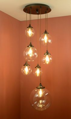 Broadstones wrought iron pendant light by Nigel Tyas ironwork Hanging Light Bulbs, Stained Glass Light, High Ceiling Lighting, Wrought Iron Pendants, Entrance Lighting, Iron Pendant Light, Cluster Pendant Lighting, Modern Pendant Light, Wrought Iron Lights