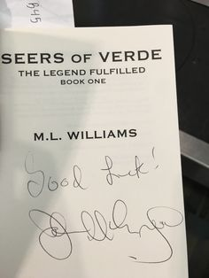 John McEnroe signing my book.