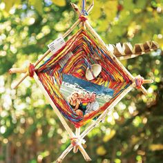Kids love this traditional Mexican yarn craft because of its fun weaving technique, and this framed variation is perfect for displaying your family's summer vacation mementos.