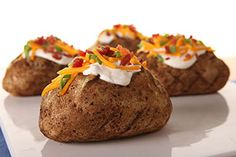 Bite into a crispy outside and fluffy inside when you try our Grilled Baked Potatoes recipe. Make these Grilled Baked Potatoes and pair with sour cream, bacon and other delicious toppings. Kraft Foods, Kraft Recipes, Grilled Baked Potatoes, Baked Potato Recipes, Grilling Recipes, Cooking Recipes, What's Cooking, Traeger Recipes, Potatoes In Microwave