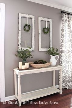 Living Room decor -  rustic farmhouse style with painted white console table, old window frames and simple greenery.