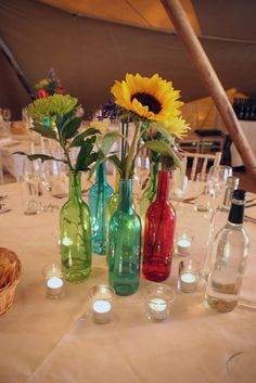 Obvi not these colors , but maybe an idea on how to arrange the bottles on tables ?