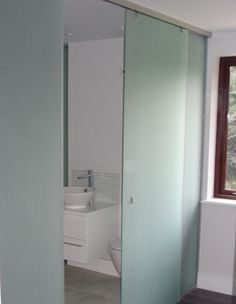Sliding frosted glass interior bathroom doors with stainless steel track and frosted glass walls Glass Bathroom Door, Glass Closet Doors, Glass Cabinet Doors, Small Bathroom, Bathroom Ideas, Bathrooms, Aluminium Door Design, Aluminium Sliding Doors, Sliding Glass Door