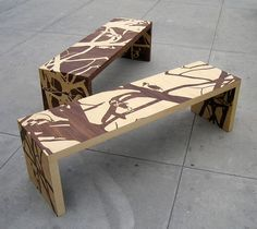 These benches, designed by Elyse Marks, are covered in skeletal animals and bare trees.