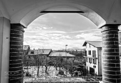Brick arch and snowy country by maxrastello