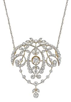 Antique Diamond Pendant Necklace. Designed as a garland style pendant, centering on a collet-set old-cut diamond, within a scrolling foliate frame, from a fine link chain accented by collet-set diamonds, mounted in 18K yellow gold and platinum, length 17 inches, pendant is detachable. Via Phillips.