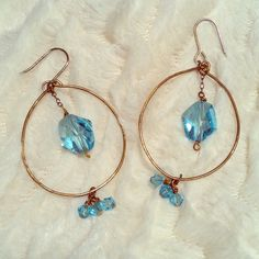 ANTHROPOLOGIE blue crystal & gold dangle earrings Up for grabs are these sparkling blue crystal earrings from ANTHROPOLOGIE. The metal is gold, and they have hook fastens. Adorable! Anthropologie Jewelry Earrings