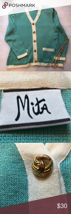 Mita vintage cardigan, size large or 14. Mita vintage cardigan, size large or 14. This cardigan is a beautiful turquoise color with cream accents at the cuffs, bottom of the jacket,  pockets and lapels. It is complemented with five lovely gold buttons. It has shoulder pads. This is in perfect condition. Thanks for visiting my closet! Mita Sweaters Cardigans