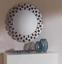 Espejo decorativo redondo de cristal con marco formado de pequeñas lunas biseladas. 90cm x 90cm x 2cm http://www.ibergada.com/Espejos-Decorativos/Novedades_Espejos%20?product_id=3470