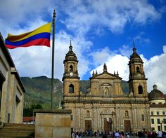 The Colombian flag flying high in Bogota, Colombia. We recommend starting your 4 week Colombia itinerary in Bogota.