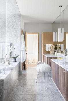 Neutral bathroom with marble walls and counters