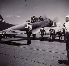 Ens. Goldsmith and his gunner J.W. Patterson of Bombing Squadron 6 climb out of their damaged SBD Dauntless after having made an emergency landing aboard USS Yorktown.