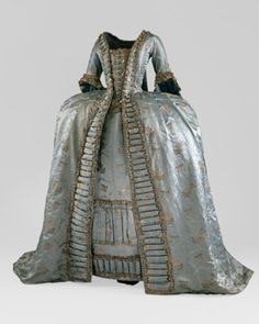 Robe a la Francaise, ca. 1765. Pale blue silk satin with hammered silver floral brocade and silver bobbin lace trim
