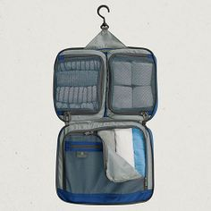Eagle Creek Pack-It™ Complete Organizer. This combines two half sized packing cubs, one full size cube and an accessories pocket. Complete with hook for easy hang & reach organization! Versatile tool to be used alternately for toiletries or clothing essentials, etc.