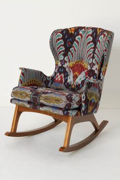 "uh oh ... as much as i hate to say it, anthropologie is killing me with their enthnopulstery! the african wingbacks are a bit too colonialist-kaleidoscope for me, but this rocking chair is quite gorgeous. but what is ikat ""motif"" fabric? Is that their way of saying it's just an ikat print rather than real woven ikat? if so, very lame."