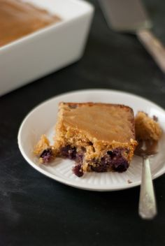 This sweet little cake, with its delicate, maple-infused crumb and jammy purple pockets, is naturally sweetened and made entirely with whole grain flours