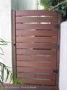 Backyard gate between side of the house and fence. Custom Ironwood Horizontal Access Gate - Play Del Rey / Pacific Palisades, CA