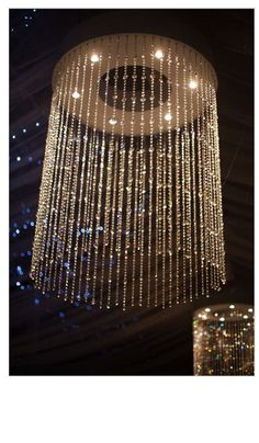 swarovski style chandelier diy, diy, how to, lighting, Pot lights mounted into the base of the wooden frame shine on the gem strings for a glittery display