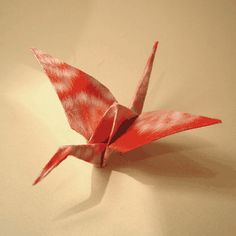 instructions for how to fold origami cranes... might be fun to have a bunch of paper cranes also