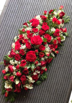 Red rose and gypsophila coffin oasis. www.butterfliesandblooms.net