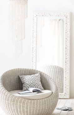 An enveloping wicker chair encourages hours of comfy lounging.