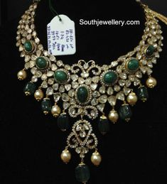82 GMs necklace studded with flat diamonds and huge green beads and south sea pearls hangings.<br>Extraordinary necklace with wonderful design and precious stones all over. Bridal Jewellery Inspiration, Bridal Jewelry Sets, Emerald Jewelry, Gold Jewelry, Diamond Jewelry, India Jewelry, Diamond Choker, Statement Jewelry, Gold Chain Design