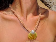 Hawaiian shell necklace  Simple yet elegant. 4 strand Poepoe style shell lei is highlighted by this rare and beautiful Moonrise shell pendant. Measures 20 inches. Moonrise shell measures 35 mm.