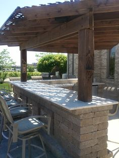A pergola is a great way to add shade to your outdoor kitchen, without overpowering the space.