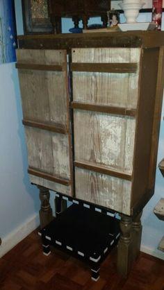 Old cabinet...added doors...added legs and wallaaaa...more bathroom storage!