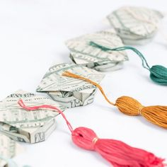 We've made the most charming origami money graduation caps and tassels to go with them!