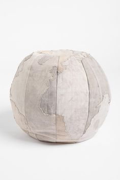 recycled canvas pouf with subtle world globe map - love that the map gives it texture instead of a bright pattern! $150 from UO