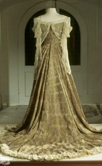 This famous peacock dress was worn by Lady Curzon at the evening ball which followed the Delhi Durbar in 1903, the glittering highlight of her husband's term as Viceroy of India. One guest wrote, 'You cannot conceive what a dream she looked'.    The dress was embroidered by Indian craftsmen with metal thread and jewels on gold cloth so it would glisten in a room lit by electricity. Admire this exquisite feat of needlework in the entrance to the Eastern Museum at Kedleston Hall, Derbyshire, England, which displays a collection of Asian objects acquired by Lord Curzon during his travels.