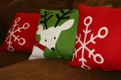 Genius!  Making Christmas pillows out of placemats!!  (These pillows sell at Target for $12.99 each, but the matching placemats are only $3.99 each - remove a few of the seams from the placemat, stuff, re-sew, and done!)