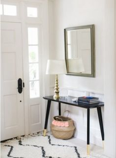 Transform a simple table into a black and gold showstopper using only spray paint and a touch of gold leaf.