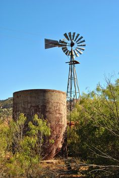 Texas Windmill  It is this picture in my memories that speaks to me of peace and life in the harsh, barrens of the earth...where the distance from water to water might mean the difference between life and death and can certainly be the distance between comfort and not....