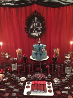 Cake and treats at an Addams Family birthday party! See more party planning ideas at CatchMyParty.com!