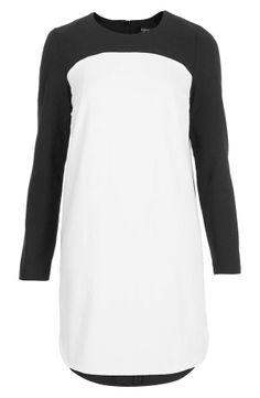 Clean modern lines define this graphic cotton shift styled with a crisp white panel in front and a sleek curved hemline. By Topshop $96.00 on @Keaton Row
