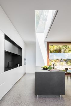 H House is a minimal residence located in Sydney, Australia designed by Marston Architects. This house in Sydney's lower north shore allows the occupants to live amongst the trees. A neutral internal material palette contrasts with the spotted gum cladding that wraps around the outdoor living spaces. There is a strong sense of indoor/outdoor with sliding doors which retract into the adjacent walls.