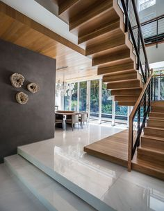 Articles about modern miami house feels its middle jungle. Dwell is a platform for anyone to write about design and architecture. Modern Miami, Modern Tropical House, Tropical Houses, Wood Staircase, Staircase Design, Staircases, Interior Exterior, Exterior Design, Room Interior