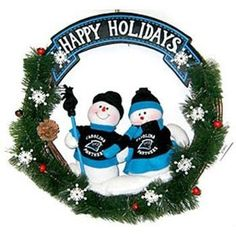 """Carolina Panthers NFL 20"""" Team Snowman Wreath by Caseys. $29.99. SC Sports NFL Holiday Wreaths. This team snowman Christmas wreath is accented with pine cones, holly berries and two snowmen dressed in official NFL team colors with an authentic logo. The wreath is 20 inches in size. Perfect for your holiday home décor, or to give as a gift to your favorite sports fan!. This team snowman Christmas wreath is accented with pine cones holly berries and two snowmen d..."""
